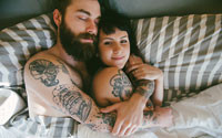 guy with beard in bed with girl