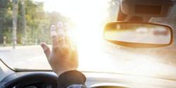 Blinding sun shining into car