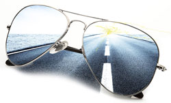 road reflected in sunglasses