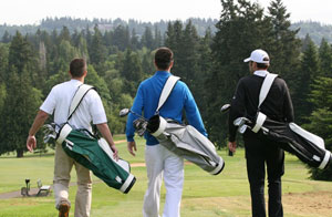 men carying golf bags