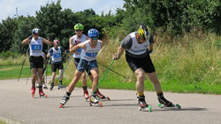 roller skiing men on the road