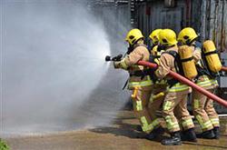 fire fighters walking towards fire