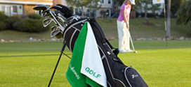 golf towel hanging from golf bag