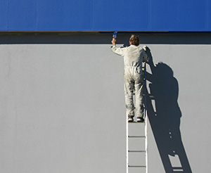 Painter at risk of falling