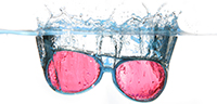 sunglasses falls and floats in water