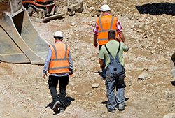 workers walking on construction site wearing safety footwear