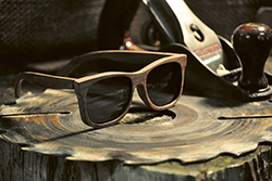 wooden frame sunglass on carved tree
